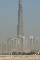 Burj Dubai tower by architecture frim SOM, sores above the other buildings. Dubai, one of the seven emirates and the most populous of the United Arab Emirates sits on the southern coast of the Persian gulf.