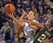 Kansas State guard Kimberly Dietz (C) drives against pressure from Baylor's Chameka Scott (R), during the second half at Bramlage Coliseum in Manhattan, Kansas, February 25, 2006. The 10 ranked Lady Bears defeated K-State 79-70.