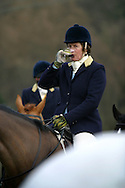 Members of the Wynnstay Hunt assemble and drink port before they ride out for a day's foxhunting. The Wynnstay Hunt, named after Sir Watkin Williams-Wynn, dated back to the 18th century and hunted on country estates in Shropshire, Cheshire and north Wales. Hunting with dogs in England and Wales became illegal on 18th February 2005 despite legal challenges to the ban and many hunts vowed to continue the ancient sport of foxhunting, risking prosecution.