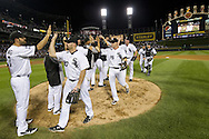 CHICAGO - JULY 06:  Jordan Danks #7, Kevin Youkilis #20, Gordon Beckham #15 and Addison Reed #43 of the Chicago White Sox celebrate with teammates after the game against the Toronto Blue Jays on July 6, 2012 at U.S. Cellular Field in Chicago, Illinois.  The White Sox defeated the Blue Jays 4-2.  (Photo by Ron Vesely)  Subject:  Kevin Youkilis; Jordan Danks; Addison Reed; Gordon Beckham