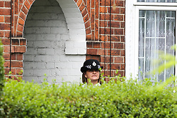 © Licensed to London News Pictures. 05/08/2019. London, UK. A police officer guards a house on Waltheof Gardens in Tottenham, north London. Police launch a murder investigation following a death of a woman at an address in Waltheof Gardens. Police were called around 10:45 am on 4 August 2019 where the body of an 89-year-old woman was found. According to the police one or more suspects gained entry to the woman's house between Saturday (3 August) evening and Sunday (4 August) morning. Photo credit: Dinendra Haria/LNP