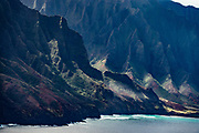 Na Pali Coast sea cliffs seen via helicopter over island of Kauai, Hawaii, USA.