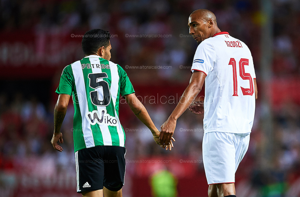 SEVILLE, SPAIN - SEPTEMBER 20:  Petros Matheus dos Santos Araœjo of Real Betis Balompie (L) shakes hands with Steven N'Zonzi of Sevilla FC (R) during the match between Sevilla FC vs Real Betis Balompie as part of La Liga at Estadio Ramon Sanchez Pizjuan on September 20, 2016 in Seville, Spain.  (Photo by Aitor Alcalde Colomer/Getty Images)