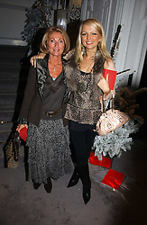 Left to right, VICKI SANDLING and her daughter HANNAH SANDLING at Garrard's Winter Wonderland party held at their store 24 Albermarle Street, London W1 on 30th November 2006.<br />