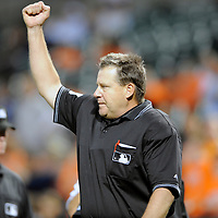 09 June 2009:  Home plate umpire Gary Cederstrom rules that Orioles third baseman Melvin Mora is out after an apparent home run because of fan interference in the 1st inning after review at Camden Yards in Baltimore, MD.  The Orioles defeated the Mariners 3-1.  ****For Editorial Use Only****