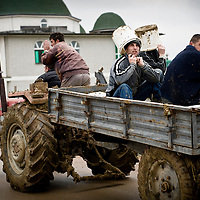 "Broja Village, Kosovo 19 February 2011<br /> A farmer transporting workers drives by the mosque of Broja<br /> After the Kosovo War and the 1999 NATO bombing of Yugoslavia, the territory of Kosovo came under the interim administration of the United Nations Mission in Kosovo (UNMIK), and most of those roles were assumed by the European Union Rule of Law Mission in Kosovo (EULEX) in December 2008. <br /> In February 2008 individual members of the Assembly of Kosovo declared Kosovo's independence as the Republic of Kosovo. Its independence is recognised by 75 UN member states. On 8 October 2008, upon request of Serbia, the UN General Assembly adopted a resolution asking the International Court of Justice for an advisory opinion on the issue of Kosovo's declaration of independence.<br /> On 22 July 2010, the ICJ ruled that Kosovo's declaration of independence did not violate international law, which its president said contains no ""prohibitions on declarations of independence"".<br /> Photo: Ezequiel Scagnetti"