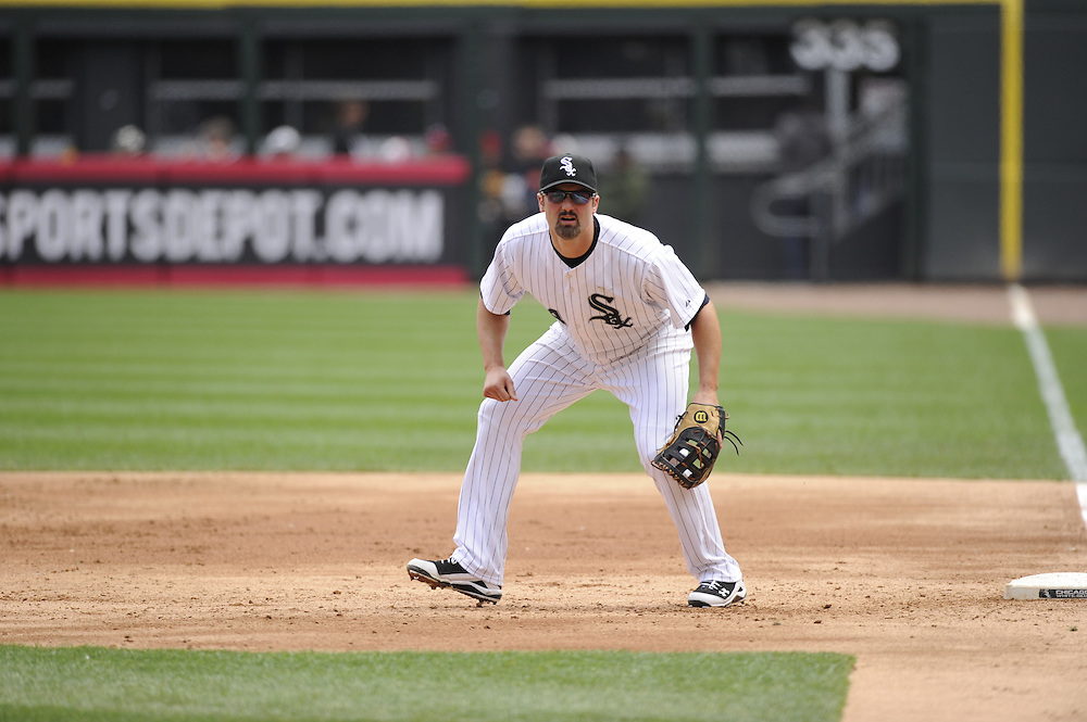 CHICAGO - APRIL 20:  Paul Konerko #14 of the Chicago White Sox fields against the Minnesota Twins on April 20, 2013 at U.S. Cellular Field in Chicago, Illinois.  The Twins defeated the White Sox 2-1 .  (Photo by Ron Vesely)   Subject:  Paul Konerko