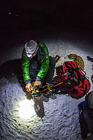 Jeff Mercier, professional alpine climber, as seen adjusting a strap of his climbing boots before the night ascent of Cascatte di Lillaz icefall.