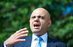Image ©Licensed to i-Images Picture Agency. 19/06/2014. London, United Kingdom. Secretary of State for Culture, Media and Sport Sajid Javid MP officially re-opens Speakers' Corner in Hyde Park following its refurbishment. Speakers' Corner in Hyde Park,<br /> Speech was disrupted by Heiko Khoo who is a Speakers' Corner regular speaker. Also speaking was Linda Lennon, CEO Royal Parks. The area is an important entrance to Hyde Park and has been refurbished to ensure it continues to be a vibrant and welcoming spot for both speakers and visitors. Picture by Elliott Franks / i-Images