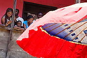 Residents watch from second-floor balconies during the parade held on the occasion of the annual Oguaa Fetu Afahye Festival in Cape Coast, Ghana on Saturday September 6, 2008..