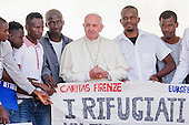 Pope Francis invites refugees to join him on stage