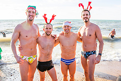 © Licensed to London News Pictures. 25/12/2016. Brighton, UK. Members of the public take part in the annual Brighton and Hove Christmas Day swim in the sea. Dozens off swimmers wear festive hats and outfits as they go for a swim on Christmas Day morning. Photo credit: Hugo Michiels/LNP