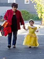 Middletown, New York  - A young girl in a costume and an adult hold hands while walking to the Halloween Fall Festival at the Middletown YMCA Center for Youth Programs on Oct. 26, 2013.