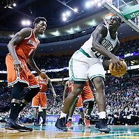 21 December 2012: Boston Celtics power forward Brandon Bass (30) looks to pass the ball over Milwaukee Bucks center Larry Sanders (8) during the Milwaukee Bucks 99-94 overtime victory over the Boston Celtics at the TD Garden, Boston, Massachusetts, USA.