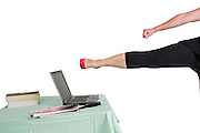 Sexy woman with red high heel shoes kicks a laptop computer
