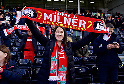 LONDON, ENGLAND - Sunday, March 17, 2019: Liverpool supporter holds James Milner's scarf before the FA Premier League match between Fulham FC and Liverpool FC at Craven Cottage. (Pic by David Rawcliffe/Propaganda)
