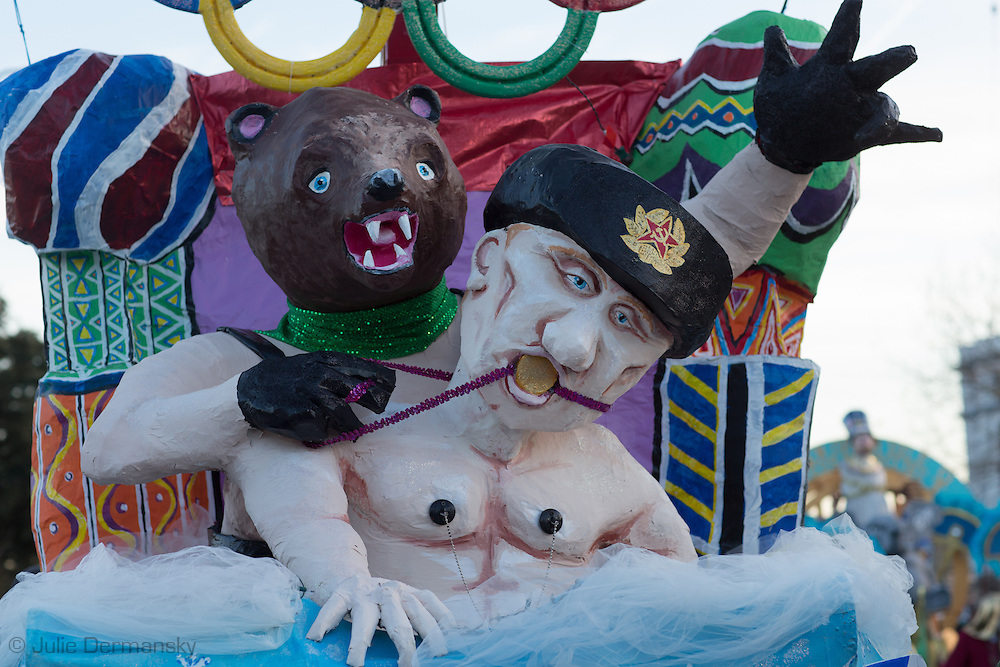 """Feb 15,  New Orleans, LA, Float satirizing the winter Olympics with a model of Putin and a bear at the helm in the Krewe du Vieux Mardi Gras parade that roles through New Orleans Marigny and French Quarter.<br /> The 2014  theme was """"Where the Vile Things Are,"""".  Krewe du Vieux is know for it  raucous irreverent satire displayed on the floats and by the Krewe members."""