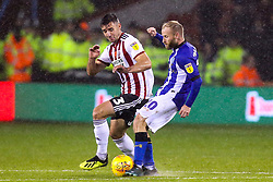 Enda Stevens of Sheffield United tackles Barry Bannan of Sheffield Wednesday - Mandatory by-line: Robbie Stephenson/JMP - 09/11/2018 - FOOTBALL - Bramall Lane - Sheffield, England - Sheffield United v Sheffield Wednesday - Sky Bet Championship