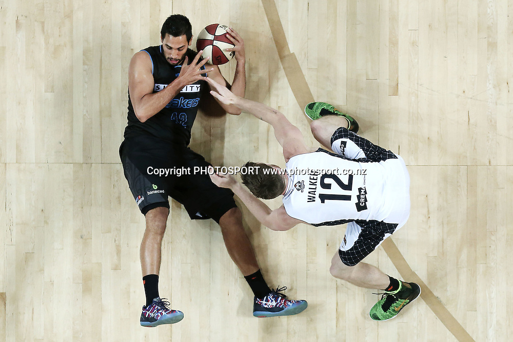 Tai Wesley of the Breakers dives for a loose ball against Lucas Walker of Melbourne United. 2014/15 ANBL, SkyCity Breakers vs Melbourne United, Vector Arena, Auckland, New Zealand. Friday 21 November 2014. Photo: Anthony Au-Yeung / photosport.co.nz