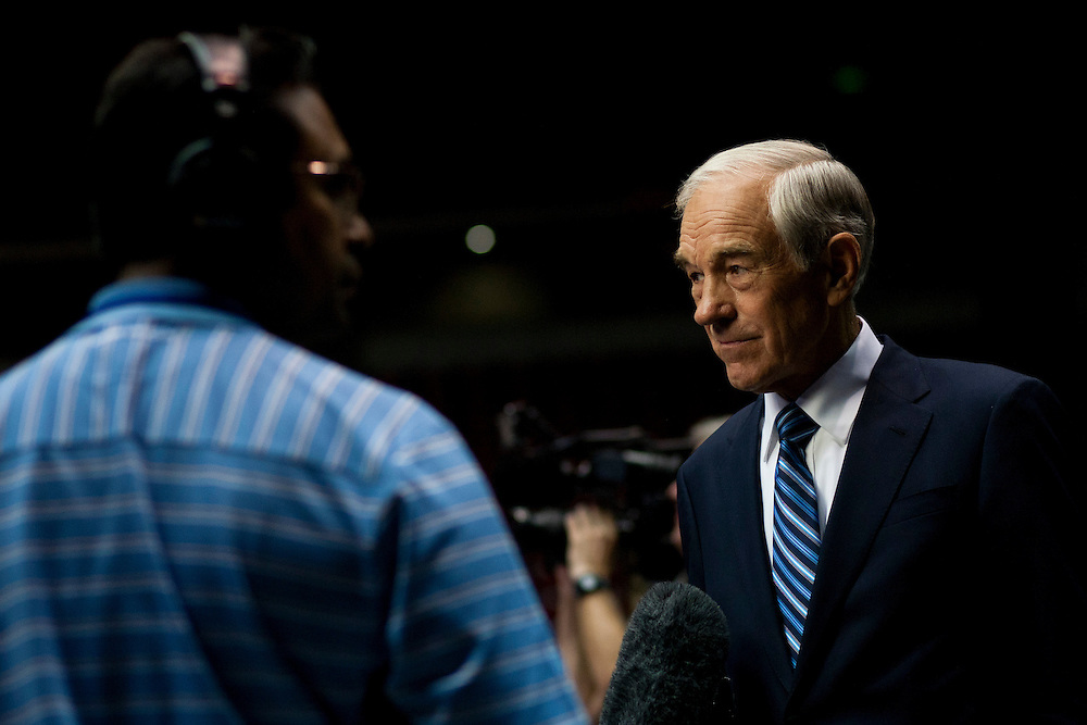 Republican presidential hopeful Ron Paul speaks to a reporter at the Republican presidential debate on Thursday, August 11, 2011 in Ames, IA.