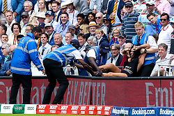 A pitch invader is lifted off the pitch at Lords during the Cricket World Cup Final - Mandatory by-line: Robbie Stephenson/JMP - 14/07/2019 - CRICKET - Lords - London, England - England v New Zealand - ICC Cricket World Cup 2019 - Final