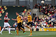 Lee Minshull of Newport (8) scores his side's third goal with a header. Skybet football league two match, Newport county v Northampton Town at Rodney Parade in Newport, South Wales on Saturday13th Sept 2014<br /> pic by Mark Hawkins, Andrew Orchard sports photography.