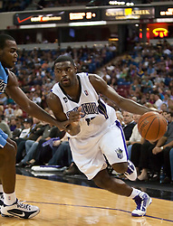 October 23, 2009; Sacramento, CA, USA;  Sacramento Kings guard Tyreke Evans (13) dribbles past Utah Jazz forward Paul Millsap (24)during the second quarter at the ARCO Arena.