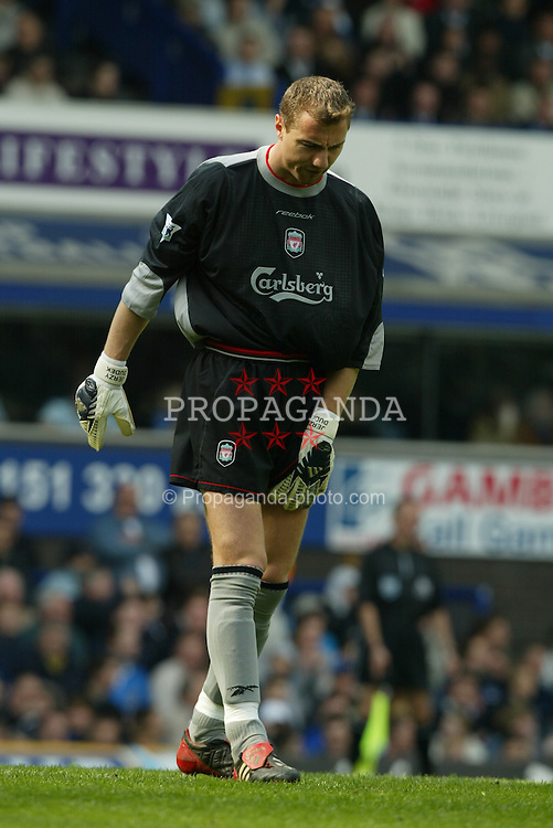 LIVERPOOL, ENGLAND - Saturday, April 19, 2003: Liverpool's Jerzy Dudek injured against Everton during the Merseyside Derby Premiership match at Goodison Park. (Pic by David Rawcliffe/Propaganda)