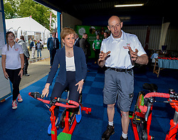 Pictured: First Minister Nicola Sturgeon on a bike at the show.<br /> <br /> Scotland's First Minister Nicola Sturgeon joined thousands of visitors attending day 2 of the 2019 Royal Highland Show at Ingliston.<br /> <br /> © Dave Johnston / EEm