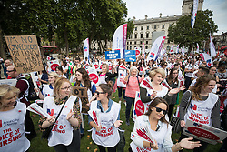 © Licensed to London News Pictures. 06/09/2017. London, UK. Nurses hold placards during a demonstration in Parliament Square. The Royal College of Nursing is campaigning against the Government's one per cent cap on public sector pay. Photo credit: Peter Macdiarmid/LNP