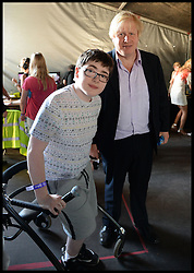 Boris Johnson with Jack Carrol  backstage at the Celebration of the 2012 Olympic Games volunteering one year on at the  Queen Elizabeth Olympic Park.<br /> Mayor of London Boris Johnson and Lord Coe will be taking to the stage at Go Local to encourage a new drive in volunteering one year on from the Games. Also present are multi-platinum selling pop rock band McFly; world famous comedian Eddie Izzard, Brit Award nominated The Feeling, and Britain'Got Talent winners Attraction, in addition to stars Jack Carroll and Gabz. The event will be the UKs biggest ever celebration of volunteering and first Olympic and Paralympic legacy event at Queen Elizabeth Olympic Park.<br /> London, United Kingdom<br /> Friday, 19th July 2013<br /> Picture by Andrew Parsons / i-Images