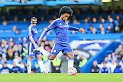 Chelsea's Willian crosses the ball during the The FA Cup third round match between Chelsea and Scunthorpe United at Stamford Bridge, London, England on 10 January 2016. Photo by Shane Healey.
