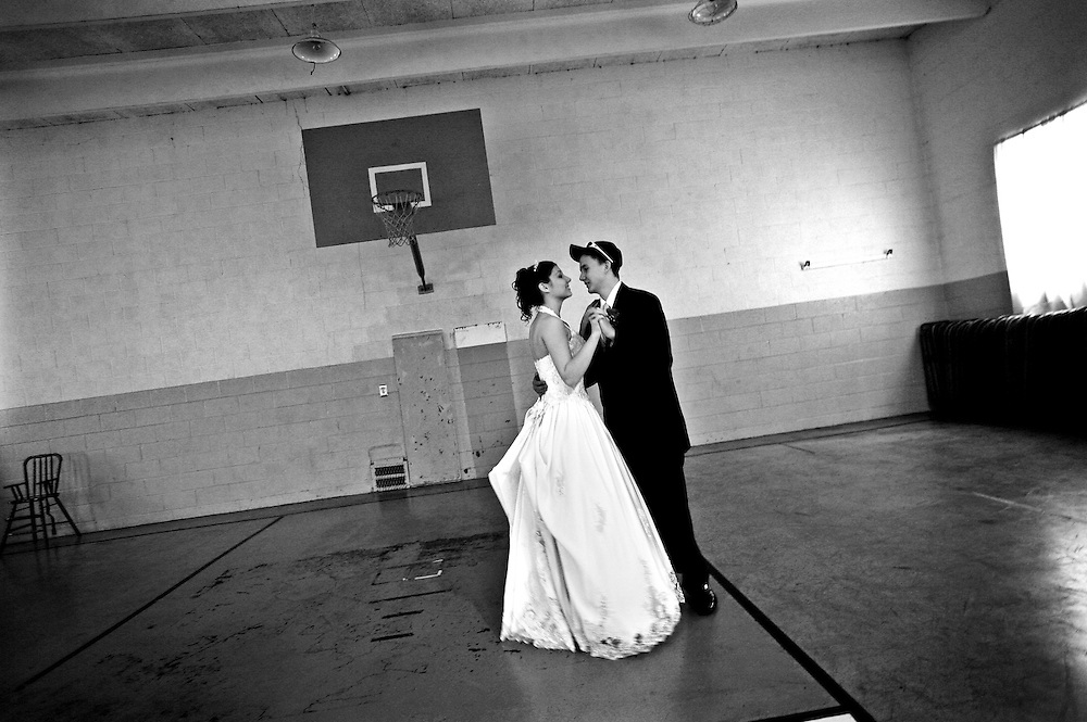 "Newlyweds, Jessica Dalton (left, age 17), and Casey Dalton (right, age 17), dance their first dance together as a married couple on the basketball court of an old gym attached to the Ghent Grace Brethren Church in Roanoke, Virginia. Jessica, who is a senior at William Fleming, and Casey, who recently received his GED, have been dating since August, and currently live together at Casey's parents house. Jessica and Casey attended William Fleming's ""A Night in Paris"" prom hours after getting married. Monday, Jessica will be back at William Fleming to finish here senior year, while Casey will go back to his job as a diesel mechanic."