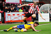 Danny Wright is tackled during the Vanarama National League match between Cheltenham Town and Altrincham at Whaddon Road, Cheltenham, England on 19 December 2015. Photo by Carl Hewlett.