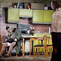 Gregor Fisher as 'Yer Granny' and Paul Riley.<br /> <br /> Yer Granny - a new production by The National Theatre of Scotland opens at the Beacon arts Centre, Greenock, Scotland.<br /> <br /> <br /> Based on La Nona by Roberto Cossa<br /> In a new version by Douglas Maxwell<br /> Directed by Graham McLaren<br /> <br /> <br /> Picture by Drew Farrell<br /> Tel : 07721-735041<br /> Image offered on a speculative basis.<br /> <br /> Yer Granny is a riotous new comedy about a diabolical 100-year-old granny who&rsquo;s literally eating her family out of house and home. She&rsquo;s already eaten their fish and chip shop into bankruptcy and now she&rsquo;s working her way through their kitchen cupboards, pushing the Russo family to desperate measures just to survive beyond 1977.<br /> <br /> As proud head of the family, Cammy is determined that The Minerva Fish Bar will rise again and that family honour will be restored &ndash; and all in time for the Queen&rsquo;s upcoming Jubilee visit. But before Cammy&rsquo;s dream can come true and before Her Maj can pop in for a chat, a single sausage and a royal seal of approval, the family members must ask themselves how far they will go to solve a problem like Yer Granny.<br /> <br /> Adapted from the smash-hit Argentinian comedy classic La Nona, the cast of Yer Granny features some of Scotland&rsquo;s best-loved performers, including Gregor Fisher in the title role, alongside Paul Riley (Still Game), Jonathan Watson (Only An Excuse?), Maureen Beattie (Casualty), Barbara Rafferty (Rab C Nesbitt), Brian Pettifer (The Musketeers) and Louise McCarthy (Mamma Mia!, West End).<br /> <br /> Performance dates :<br /> The Beacon Arts Centre, Greenock<br /> 19/05/2015&nbsp;-&nbsp;21/05/2015 <br /> <br /> King's Theatre, Glasgow<br /> 26/05/2015&nbsp;-&nbsp;30/05/2015 <br /> <br /> King's Theatre, Edinburgh<br /> 02/06/2015&nbsp;-&nbsp;06/06/2015 <br /> <br /> Eden Court, Inverness<br /> <br /> Lyric Theatre, Belfast<br /> 23/06/2015&nbsp;-&nbsp;27/06/2015 <br /> <br /> Dundee Rep Theatre<br /> 30/06/2015&nbsp;-&nbsp;04/07/2015