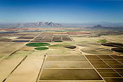 Center pivot irrigation (sometimes called central pivot irrigation) is amethod of crop irrigation in which equipment rotates around a pivot.