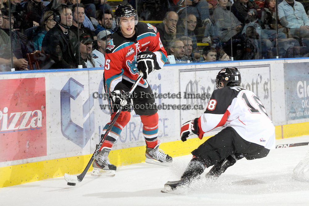 KELOWNA, CANADA, OCTOBER 26:  Colton Heffley #25 of the Kelowna Rockets looks for the pass as the Prince George Cougars visit the Kelowna Rockets  on October 26, 2011 at Prospera Place in Kelowna, British Columbia, Canada (Photo by Marissa Baecker/Shoot the Breeze) *** Local Caption *** Colton Heffley;