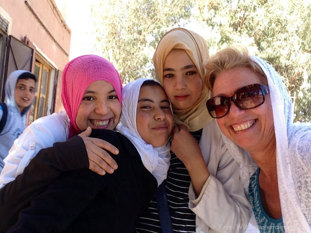 Taking cellphone selfie with timid local girls in Morocco.