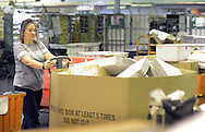 Tammy Gray pushes a bin of packages during the early morning sorting of mail and parcel packages at the Langhorne Post Office Tuesday, November 29, 2016 in Langhorne, Pennsylvania. (Photo by William Thomas Cain)
