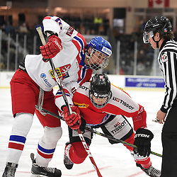 COBOURG, - Dec 18, 2015 -  WJAC Game 11- Team Czech Republic vs Team Switzerland at the 2015 World Junior A Challenge at the Cobourg Community Centre, ON. Ondrej Najman #10 of Team Czech Republic battles for the puckwith Yannick Lerch #18 of Team Switzerland during the first period.<br /> (Photo: Andy Corneau / OJHL Images)