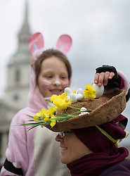 © licensed to London News Pictures. London, UK 31/03/2013. A mother and daughter dressed as Easter Bunnies to celebrate Easter before joining Easter Bunny Stroll to skate in central London on Sunday 31 March 2013. Photo credit: Tolga Akmen/LNP