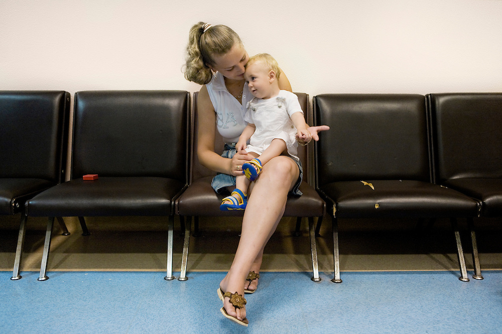 Milan, Italy, June 2008. Centre for immigrant women's health, San Carlo Hospital. Roxana, Romanian mother, 20 years old, and her son Luca Andrei, waiting for the pediatric visit...Milano, Italia, Giugno 2008. Centro di salute e ascolto donne immigrate, Ospedale San Carlo. Roxana, mamma romena, 20 anni, con il figlio Luca Andrei, in attesa della visita pediatrica....