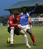 Photo: Lee Earle.<br /> Portsmouth v Manchester United. The Barclays Premiership. 11/02/2006. United's Ruud van Nistelrooy (L) battles with Linvoy Primus.