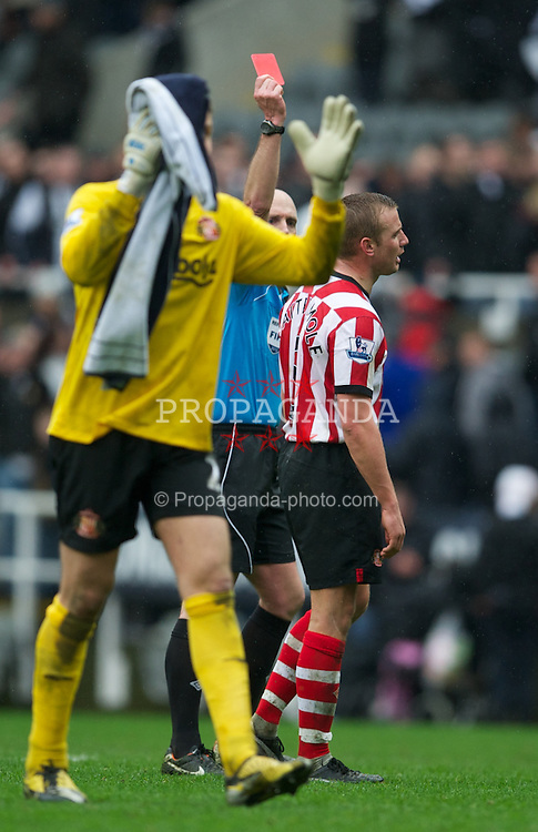 NEWCASTLE, ENGLAND - Sunday, March 4, 2012: Referee Mike Dean shows the red card to Sunderland's captain Lee Cattermole after the final whistle during the Premiership match against Newcastle United at St. James' Park. (Pic by David Rawcliffe/Propaganda)
