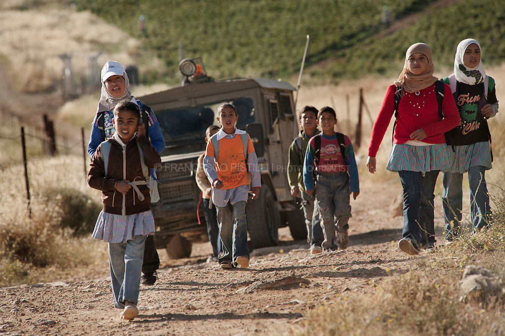 School Patrol from Ma'on to At Tuwani. Israeli army defending students from settler attacks and violence.