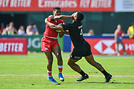Josiah Morra of Canada is tackled by Salesi Rayasi of New Zealand <br /> <br /> Photographer Craig Thomas/Replay Images<br /> <br /> World Rugby HSBC World Sevens Series - Day 2 - Friday 6rd December 2019 - Sevens Stadium - Dubai<br /> <br /> World Copyright © Replay Images . All rights reserved. info@replayimages.co.uk - http://replayimages.co.uk