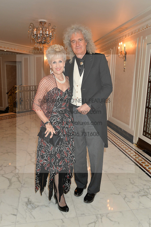BRIAN MAY and ANITA DOBSON at the David Shepherd Wildlife Foundation 30th anniversary Wildlife Ball at The Dorchester, Park Lane, London on 10th October 2014.