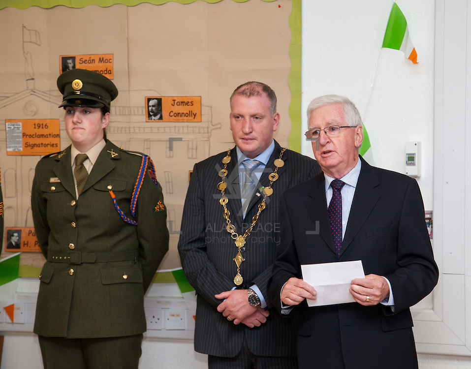 23/10/2015       <br /> Members of the Defence Forces were in Abbeyfeale today to present a handmade Tricolour and a copy of the Proclamation of the Irish Republic to students of the town's two primary schools.<br /> <br /> St Marys Boys National School and Scoil Mh&aacute;thair D&eacute; are among 3,000 schools nationally and 152 Limerick primary schools to receive the presentation as part of initiatives to mark the centenary of the 1916 Rising.&nbsp;<br /> <br /> Councillor Liam Galvin, Mayor of the City and County of Limerick joined pupils and teachers for today's presentation ceremony, which saw representatives of the Defences Forces raise the flag and read the Proclamation. <br /> <br /> Attending the ceremony at St. Marys Boys National School were, Private Ciara Quinn, Mayorof Limerick Cllr. Liam Galvin and Con Daly, Chairman of The Board St. Marys BNS. Picture: Alan Place.