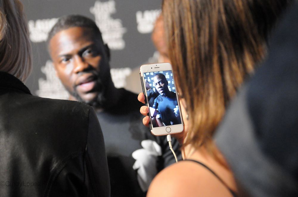 Actor/comedian Kevin Hart answers questions to the media on the red carpet at the Just For Laughs comedy festival. Hart was in Montreal hosting the Eat my Shorts film screening at the Imperial theatre where the top 5 short films were screened and vying for a development deal with Hart's Laugh Out Loud Network. July 2017. (Cult MTL)