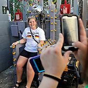 Gail Carroll takes a photo of Amy Murk on a piece of memorabilia at Graceland Too in Holly Springs, Miss., Tuesday, Aug. 12, 2014. (Photo/Thomas Graning)